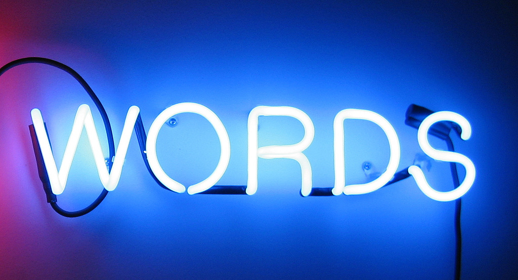 A neon sign reading WORDS.