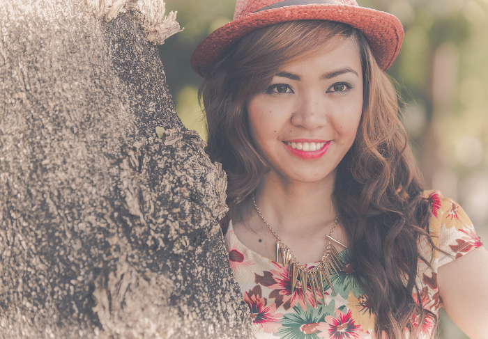 A light-skinned Asian woman smiling at the camera.