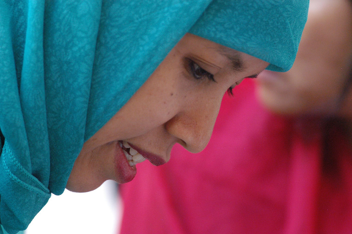 A woman wearing a head scarf.