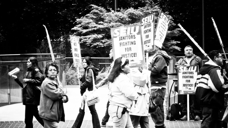 A black and white image of SEIU janitors protesting for fair wages.