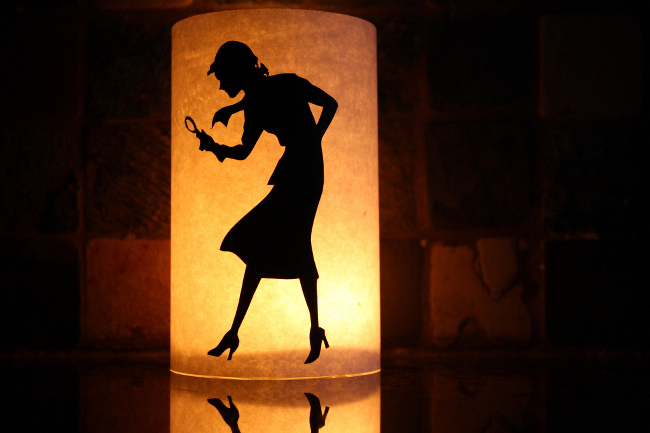 A lantern with a Nancy Drew cutout.