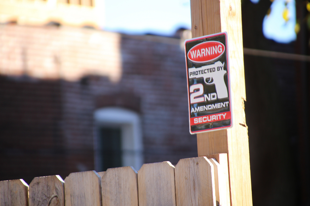 A sign with a gun on it warning that a home is protected by Second Amendment Security