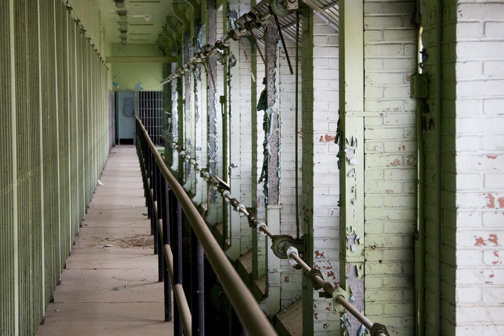 A row of grim-looking prison cells.