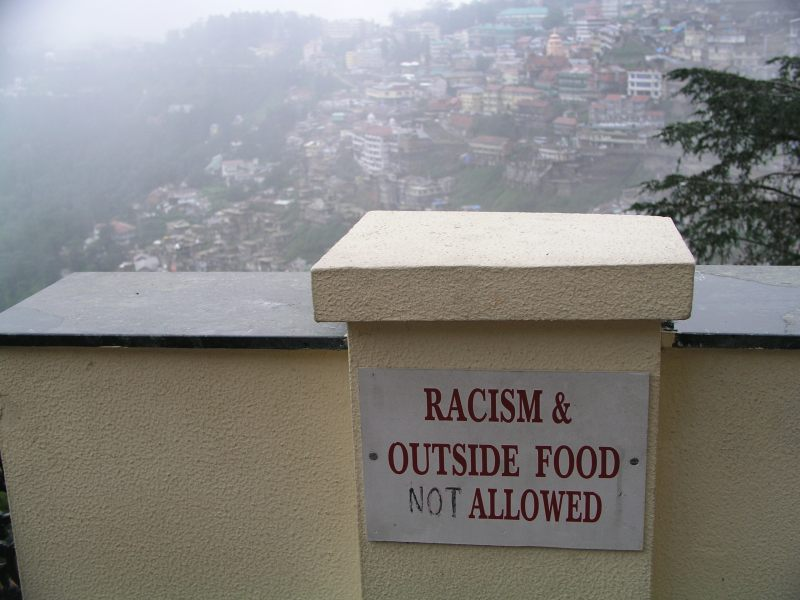A sign advising visitors that racism and outside food are not allowed.