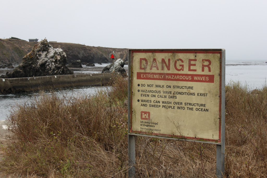 A sign warning about hazardous waves.