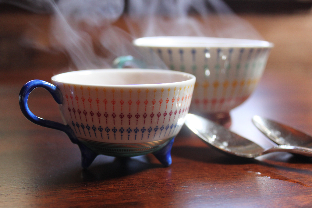 Two steaming cups of tea.