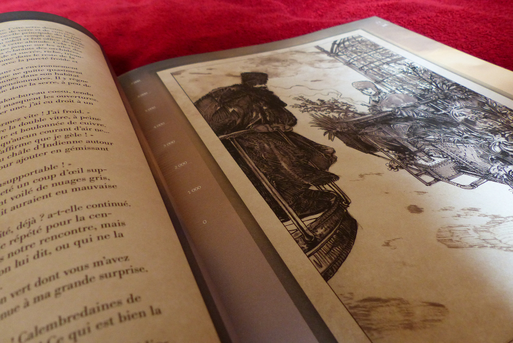 A book laid open to an illustration.