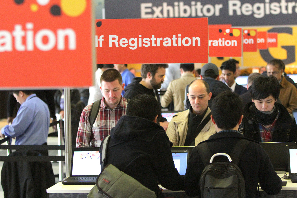 Attendees at a conference lining up to register.