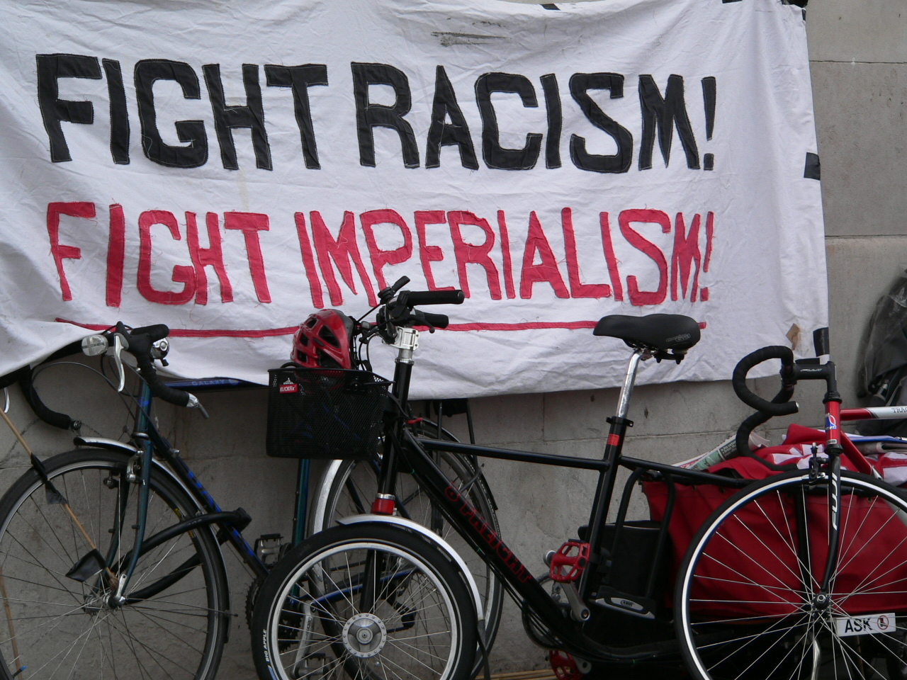 A sign advising the viewer to fight racism and imperialism