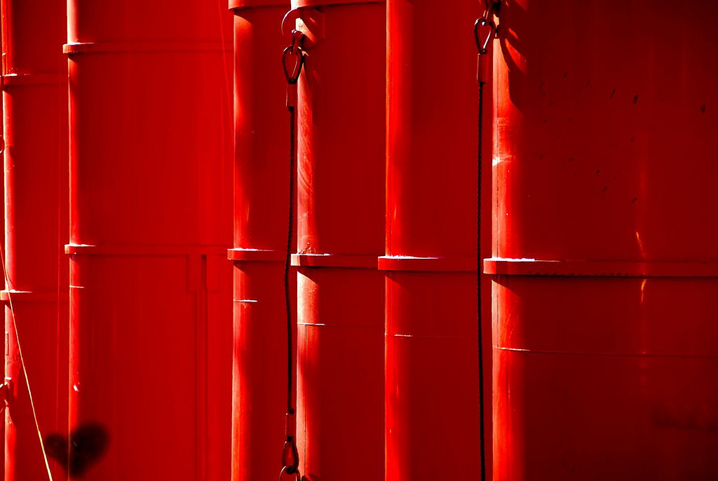 A row of bright red barrels.