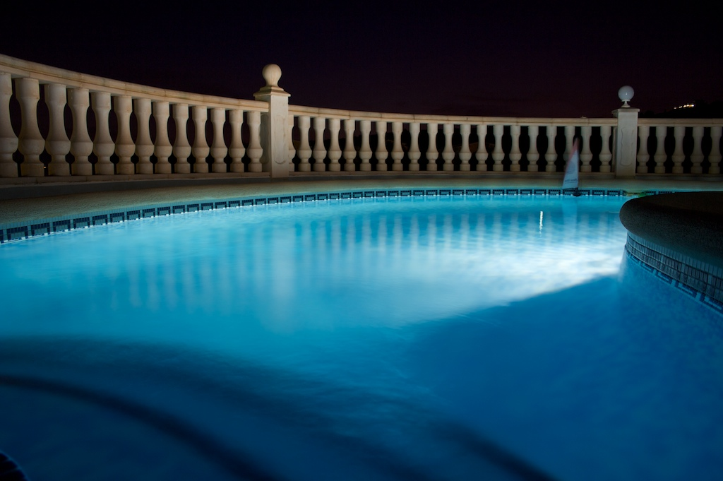 A swimming pool at night.